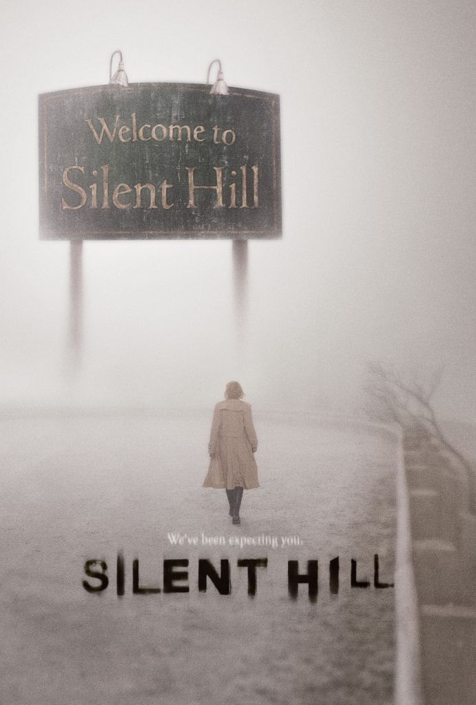 """Silent Hill Movie Poster. The main character Rose is seen walking down a foggy road. To the left is a sign that says """"Welcome to Silent Hill"""" and a tagline states """"We've been expecting you"""" in a blurred font that is meant to look spooky circa 2000s definition of spooky font."""